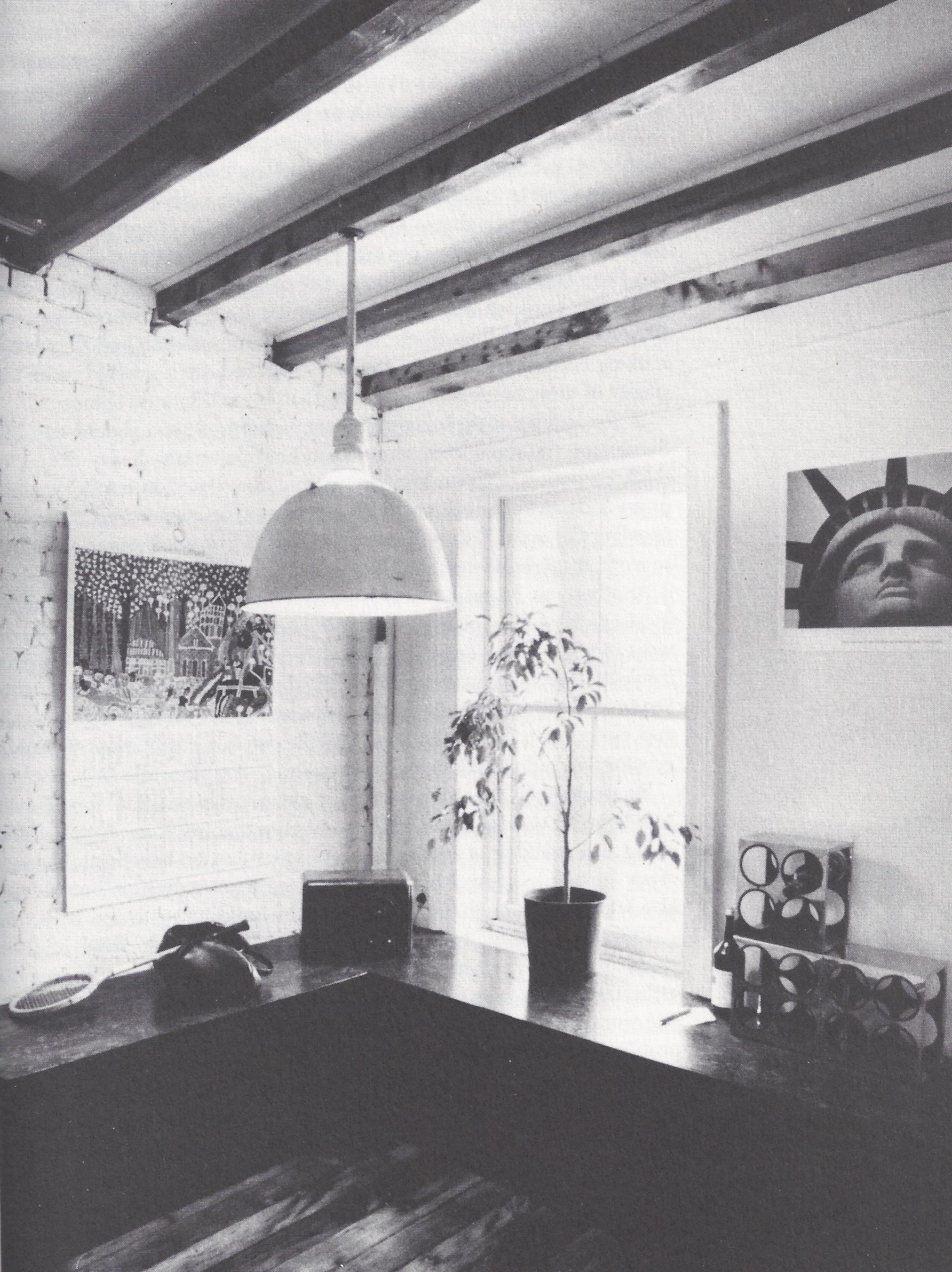 timber beams brick wall modern hanging light fixture